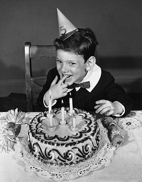Little boy w/ birthday cake & party hat