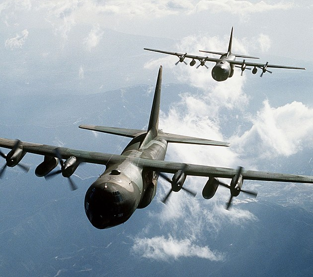 Two C 130E Hercules Aircraft Flying Over Mountainous Terrain